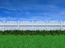 Fence on a grass field under a blue sky. 3D illustration of white wood fence with ground cover growing alongside on a grass field under a clear blue sky Stock Photo