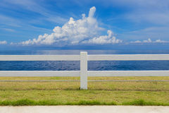 The fence on grassland and cloud blue sky Royalty Free Stock Photography