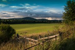 Fence by Grassland and Hills Stock Images