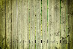 Fence of greenish boards. Empty background with vignette. Texture of wooden slats. Fence of greenish boards. Empty background with vignette. Texture of old royalty free stock photography