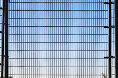 Fence with grid structure with blue Stock Images