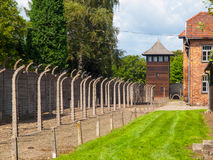Fence and guard tower of concentration camp Royalty Free Stock Images
