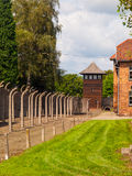 Fence and guard tower of concentration camp Stock Image
