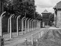 Fence and guard tower of concentration camp Stock Photography