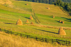 Fence and haystack in mountain Royalty Free Stock Images