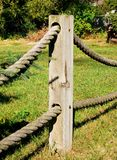 Fence with heavy robe. An private fence post connected with heavy twisted robe Royalty Free Stock Images