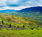 Fence on hillside meadow. Royalty Free Stock Photos