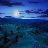 Fence on hillside meadow in mountain at night Royalty Free Stock Photography