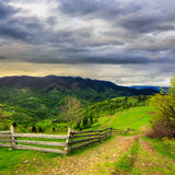 Fence on hillside meadow in mountain Royalty Free Stock Image