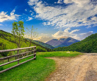 Fence on hillside meadow in mountain Royalty Free Stock Images