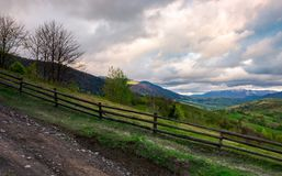 Fence on a hillside of mountainous countryside. Lovely rural scenery in springtime stock images