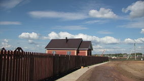 Fence, house, clouds stock video footage