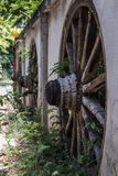 Fence houses in Asia, with pasted vintage wagon wheel Stock Photos
