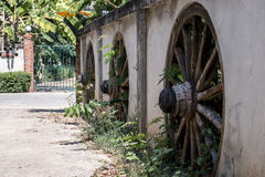 Fence houses in Asia, with pasted vintage wagon wheel Stock Photography