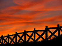 Fence In A Summertime Sunset Stock Images