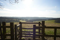 Fence and kissing gate in a rural landscape Stock Photos