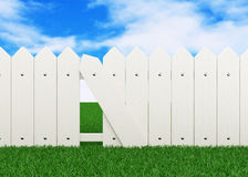 Fence on lawn Royalty Free Stock Image