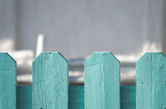 The fence. A light blue green fence on a beach Royalty Free Stock Photos