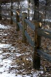 Fence Line. Weathered wooden fence line with snow royalty free stock images