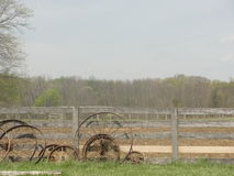 Fence lined with rims Stock Photos