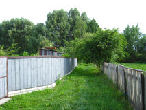 Fence and little street in rural manor Stock Image