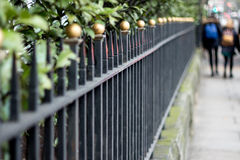 Fence childeren going to school Royalty Free Stock Photos
