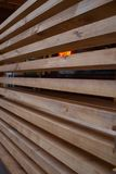 Fence of long square wooden boards. Vertical. Fence of long square wooden boards stock photo
