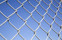 Fence made of  barbed wire Stock Photo