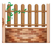 A fence made of bricks and woods Stock Photography