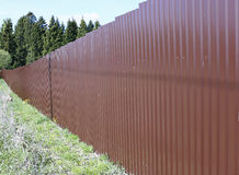 Fence made of brown metal professional flooring Stock Photography