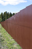 Fence made of brown metal professional flooring. A fence made of brown metal professional flooring Stock Photography