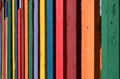 Fence made from colorful wooden planks. Fence made from wooden planks painted in different vivid colors. Angle view. Background royalty free stock images