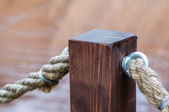 Fence made of cord and wooden pier Stock Image