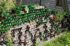 A fence made of empty glass bottles Royalty Free Stock Image