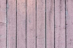 Fence made of flat vertical boards. Background with the texture of wooden slats. Old fence made of flat vertical boards. Background with the texture of wooden royalty free stock images