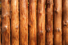 Fence made of logs as background Royalty Free Stock Photos