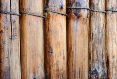 A fence made of logs. A fence made of logs bound with rope Royalty Free Stock Images