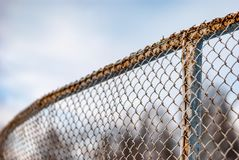 Fence made of metal mesh Stock Images