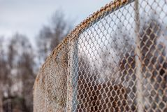 Fence made of metal mesh Royalty Free Stock Image