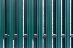 The fence is made of metal plates. royalty free stock image