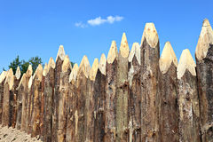 A fence made of pointed logs Stock Images