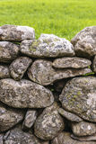 Fence made of rough stones Stock Photos