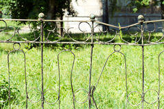 Fence made of rusty metal rods. Very old and rusty. The backgrou Stock Image