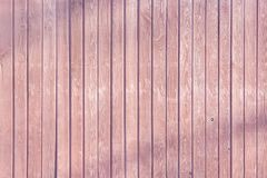 The fence is made of smooth wooden slats of light pink color. stock photography