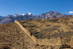 Fence made of stone in the mountains, Himalayas, Nepal stock photo