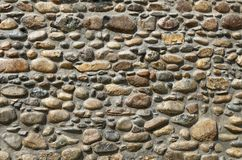 Stone fence. The fence is made of stones of different size and shape royalty free stock image