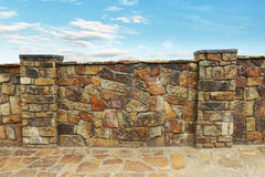 Fence made of stones Royalty Free Stock Image