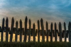 A fence made of wooden peak at sunset.  royalty free stock images