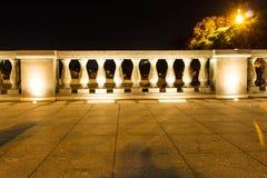 Fence, marble pillars with illuminated lanterns. Evening. Fence, marble pillars with illuminated lanterns.nFence, marble pillars with illuminated lanterns royalty free stock image