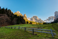 Fence in meadow in the Dolomites Stock Photo